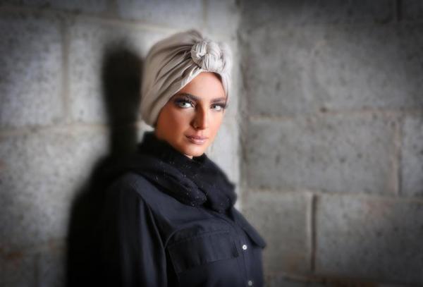 51892647fa064 مجلة زهرة السوسن - ملابس محتشمة وعصرية من نبيلة الناظر